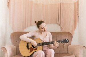 girl practicing guitar