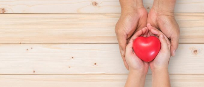 Parent handing Heart to Child