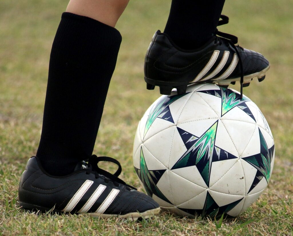 cleats and soccer ball