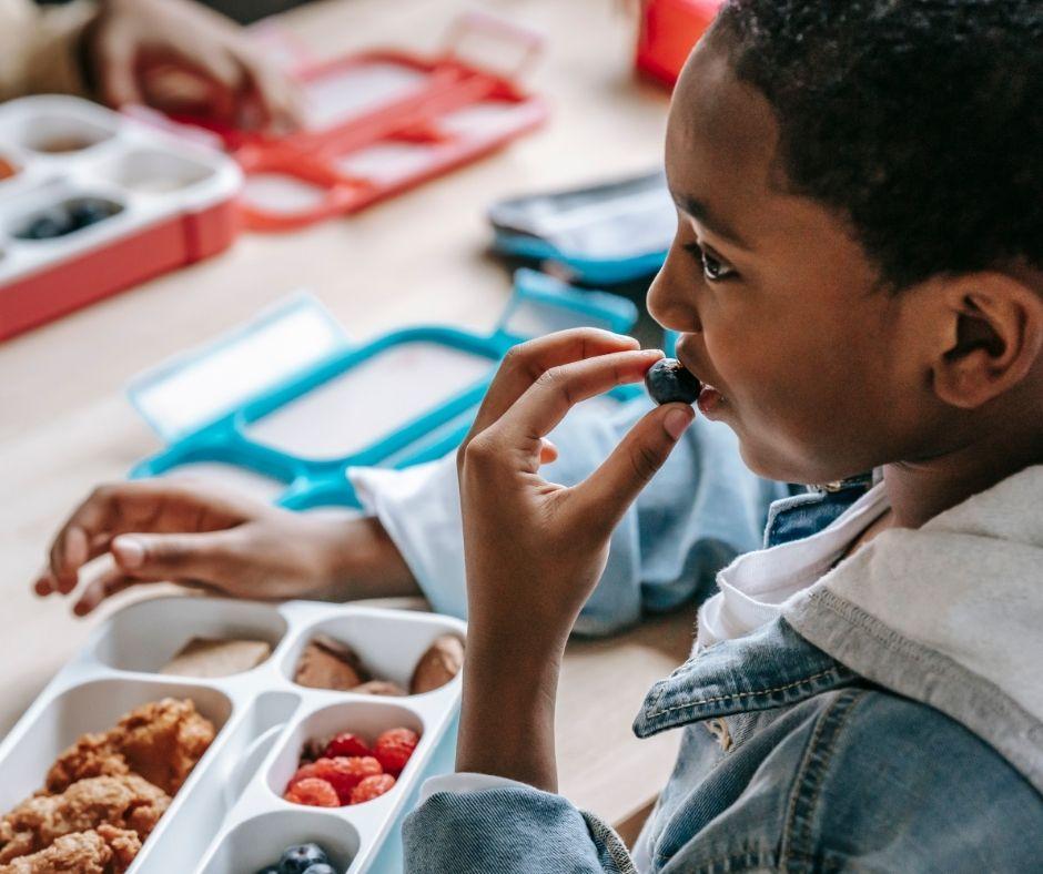 boy eating lunch at school